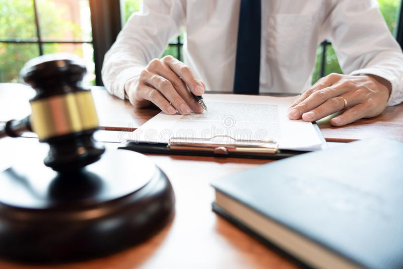 Lawyer or judge business man working with paperwork agreement contract and gavel in Courtroom, Justice and Law firm Notary public. Concept royalty free stock photos