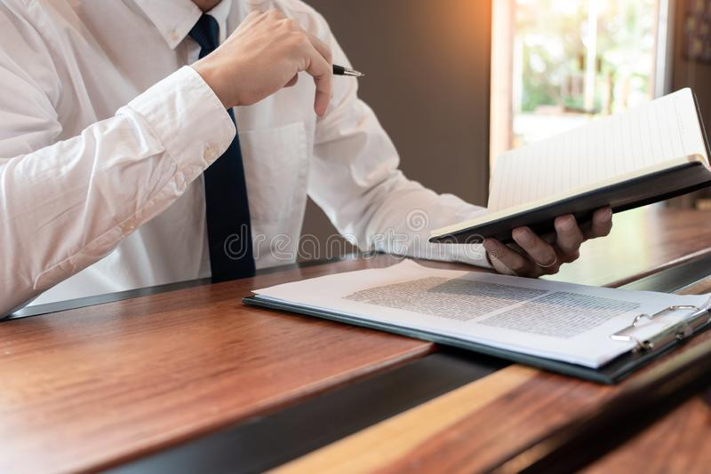Lawyer or judge business man working with paperwork agreement contract and gavel in Courtroom, Justice and Law firm Notary public. Concept stock image