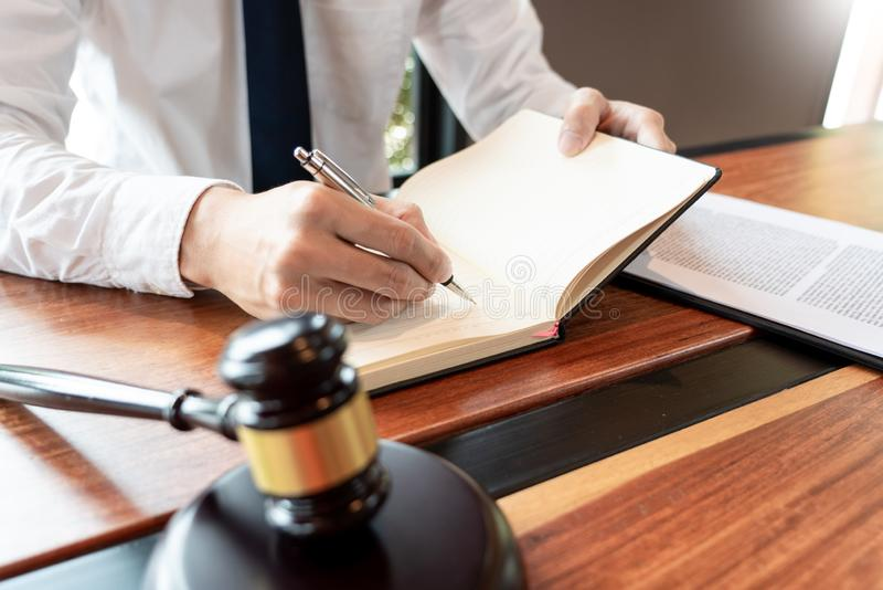 Lawyer or judge business man working with paperwork agreement contract and gavel in Courtroom, Justice and Law firm Notary public. Concept stock photos