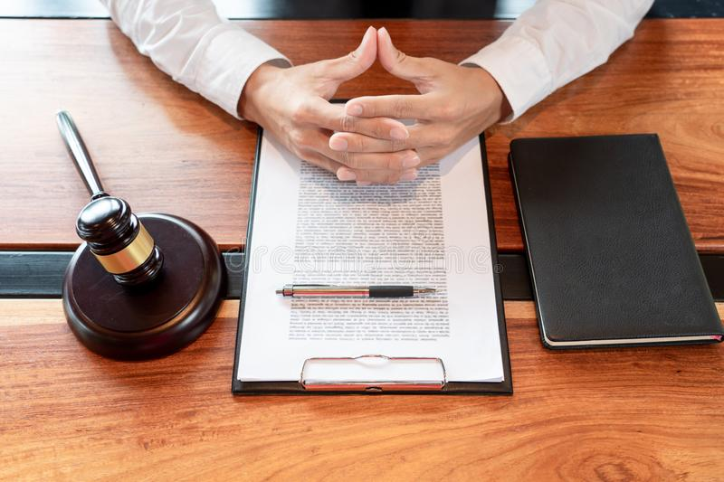 Lawyer or judge business man working with paperwork agreement contract and gavel in Courtroom, Justice and Law firm Notary public. Concept royalty free stock images
