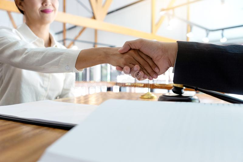 Lawyer or judge  with gavel and balance handshake with client stock image