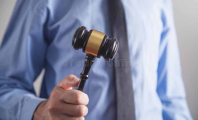 Lawyer or judge holding gavel. Law and justice stock photos