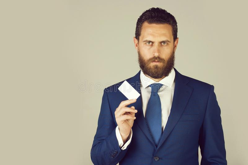 Lawyer or man with business or credit card, business ethics. Lawyer or man with business or credit card in blue formal outfit on grey background, copy space stock images