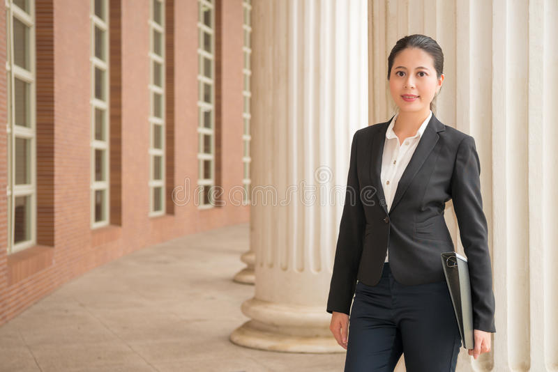 Lawyer manager standing in justice court outdoor. Smiling confidently woman lawyer manager standing in justice fair court outdoor and holding legal related royalty free stock photography