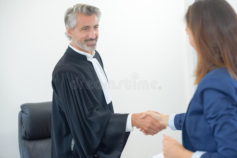 Lawyer meeting client in courthouse office royalty free stock photography