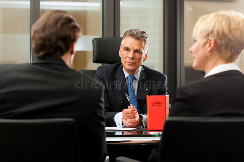 Lawyer or notary with clients in his office royalty free stock images