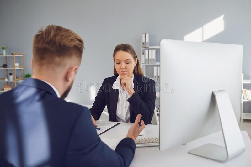 Lawyer notary woman at a meeting with a male client in the office royalty free stock photo