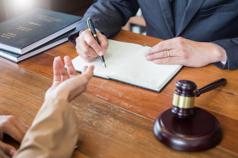 Lawyer in office. Counseling and giving advice about legal legislation in courtroom to help customer, tribunal and justice concept stock photos
