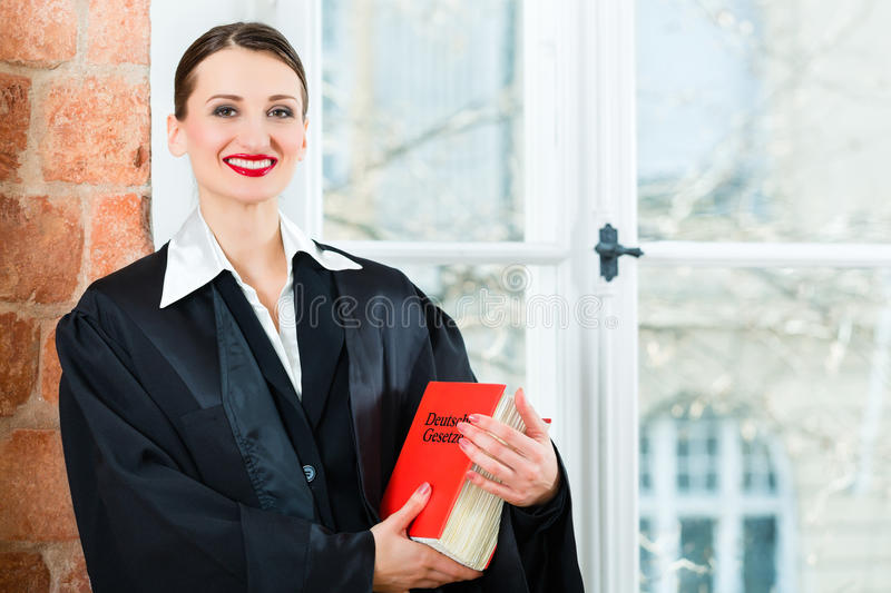 Lawyer In Office Reading Law Book Stock Photo