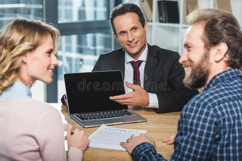 Lawyer pointing at laptop stock photos