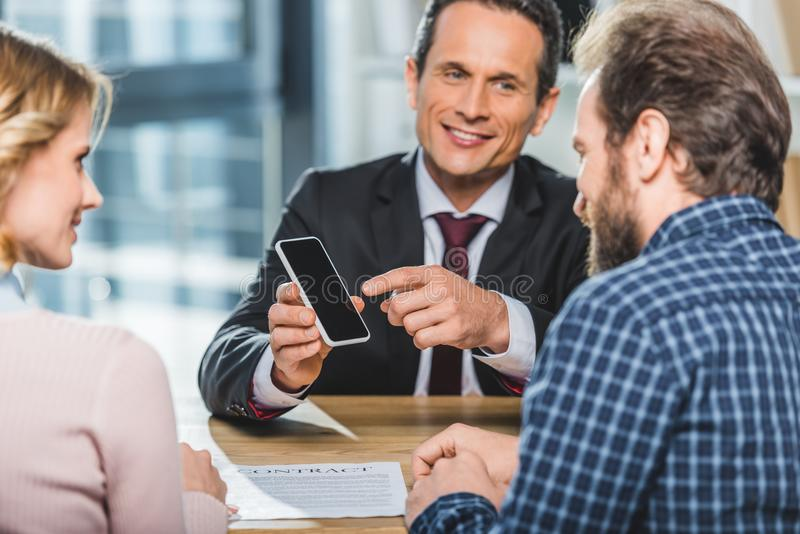 Lawyer pointing at smartphone stock photo