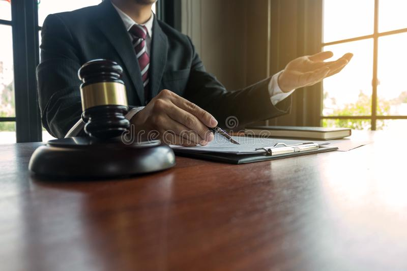 Lawyer present client with contract papers on the table in office. consultant lawyer, attorney, court judge, concept.  stock photos