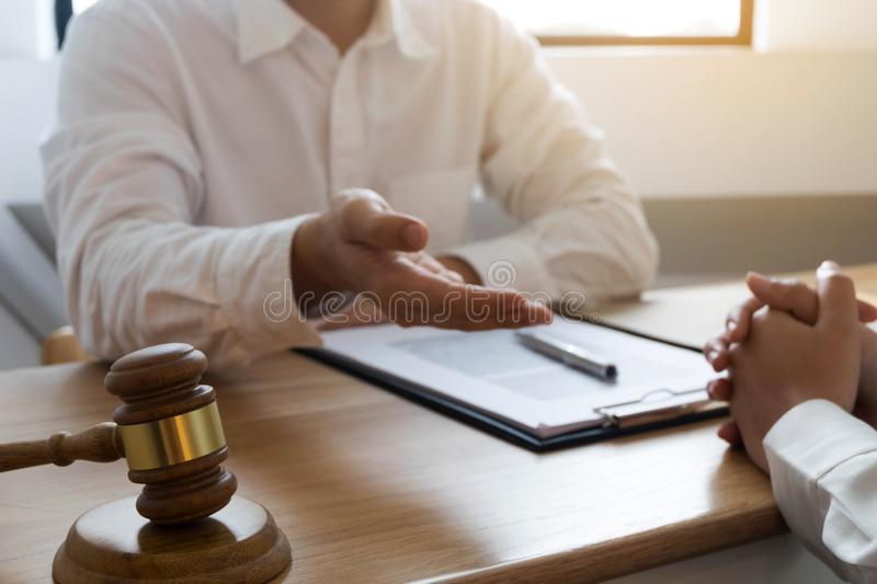 Lawyer present client with contract papers on the table in office. consultant lawyer, attorney, court judge, concept.  royalty free stock photos