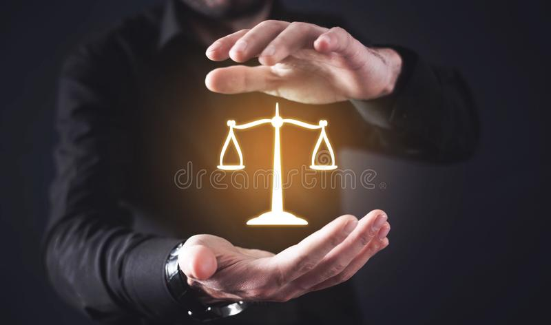 Lawyer protect scales of justice. Law and Justice stock photos