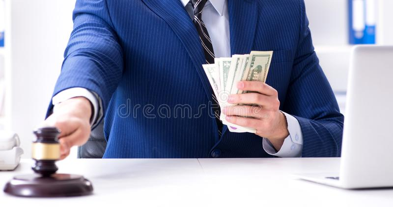 Lawyer receiving money as bribe. The lawyer receiving money as bribe royalty free stock images