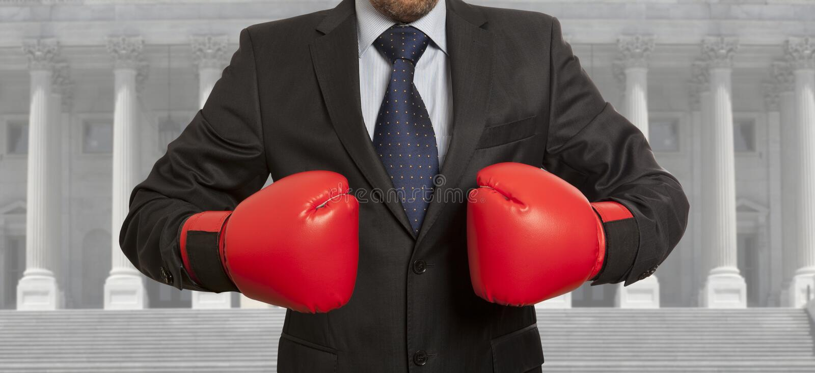 The lawyer in red boxing gloves royalty free stock photography