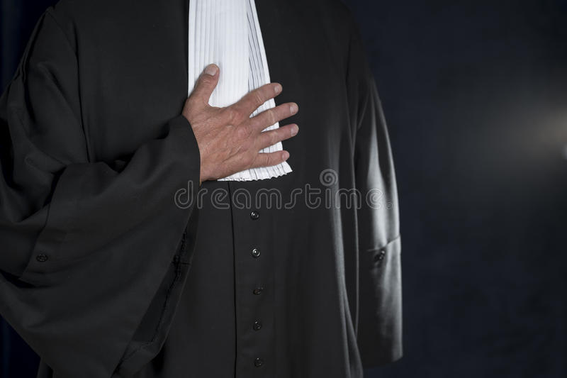 Lawyer in robe with jabot hands close up judge royalty free stock photos