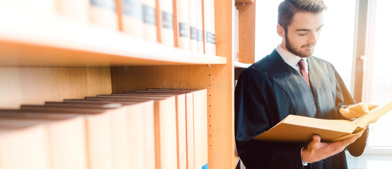 Lawyer with robe ready for court reading after the law one last time royalty free stock images