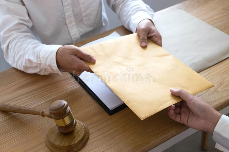 Lawyer send a contract documents to client in office. consultant lawyer, attorney, court judge, concept stock images