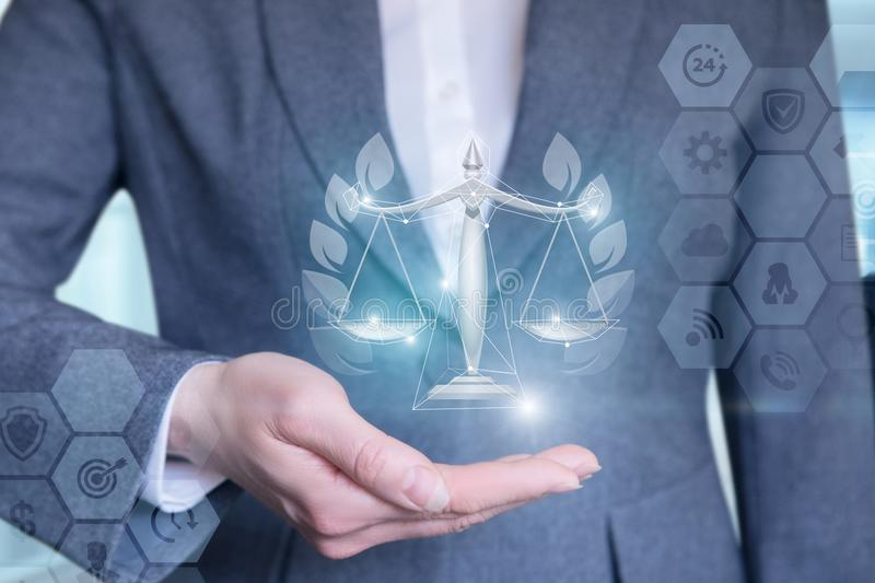Lawyer shows the scales of justice. royalty free stock image