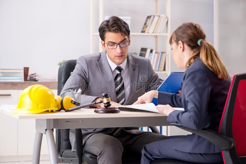 The lawyer talking to client in office. Lawyer talking to client in office stock images