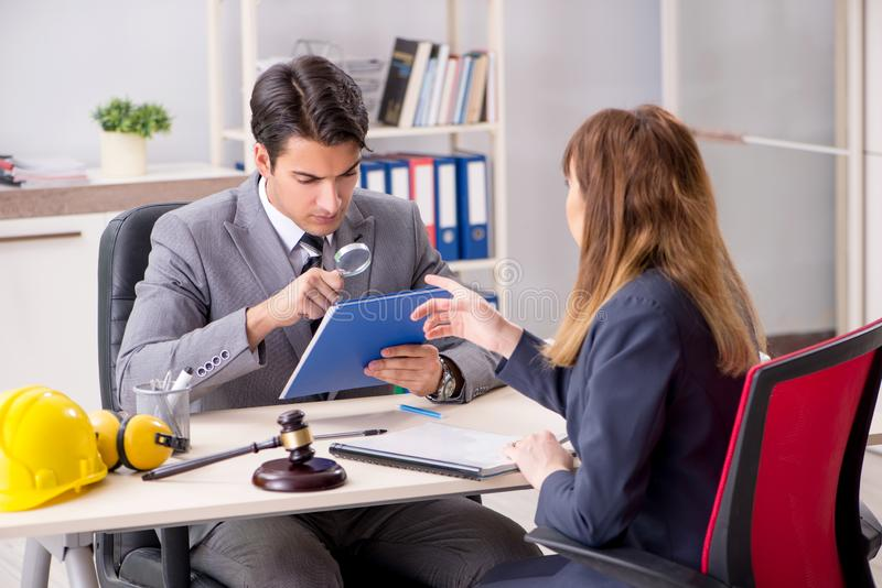 The lawyer talking to client in office. Lawyer talking to client in office stock photos