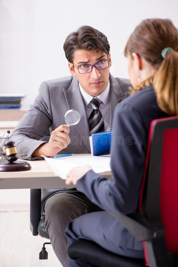 The lawyer talking to client in office. Lawyer talking to client in office royalty free stock images