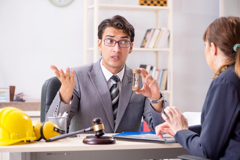 The lawyer talking to client in office. Lawyer talking to client in office stock photography