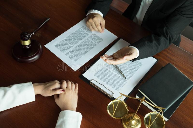 Lawyer working with contract client on the table in office. consultant lawyer, attorney, court judge, concept.  royalty free stock image