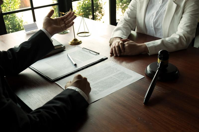Lawyer working with contract client on the table in office. consultant lawyer, attorney, court judge, concept.  stock photo