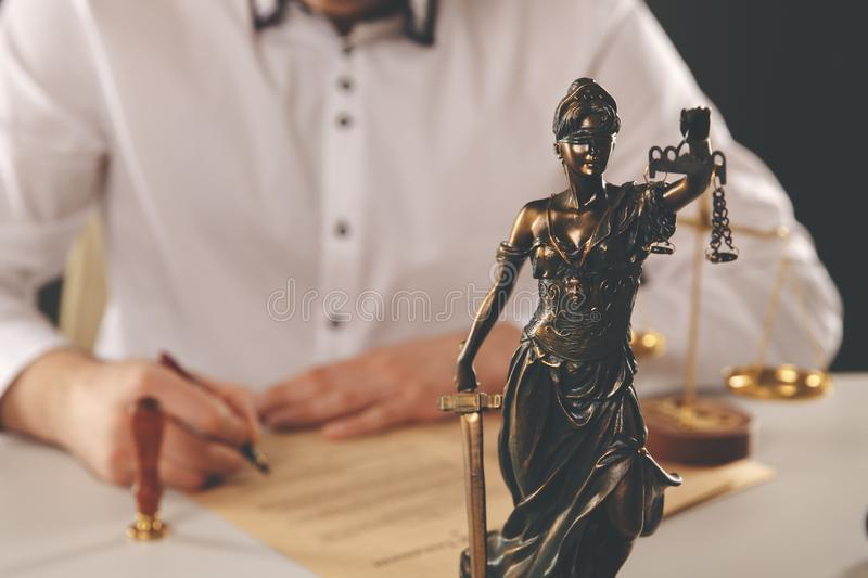 Male lawyer working with contract papers and wooden gavel on tabel in courtroom. justice and law ,attorney, court judge. Lawyer working with contract papers and stock images