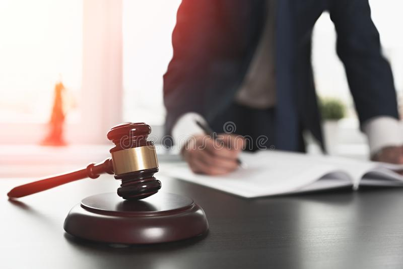 Lawyer working with documents. Justice concept. Lawyer working with documents. Justice and law, attorney, concept. Man signing contract papers stock photo