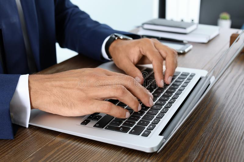 Lawyer working with laptop at table. Closeup royalty free stock photo