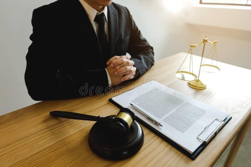 Lawyer working on the table in office. consultant lawyer, attorney, court judge, concept. stock photo
