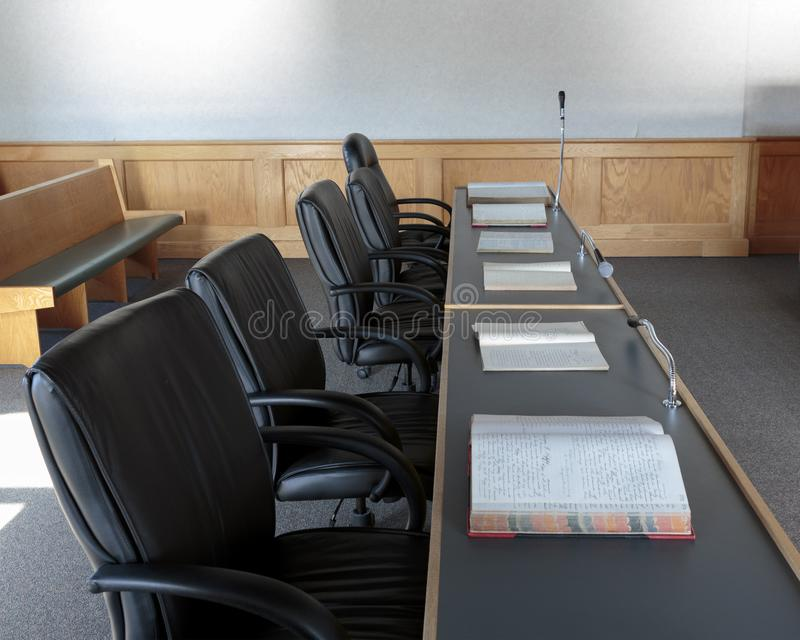 Lawyers bench in courtroom. Lawyers bench with books in a courtroom stock photos