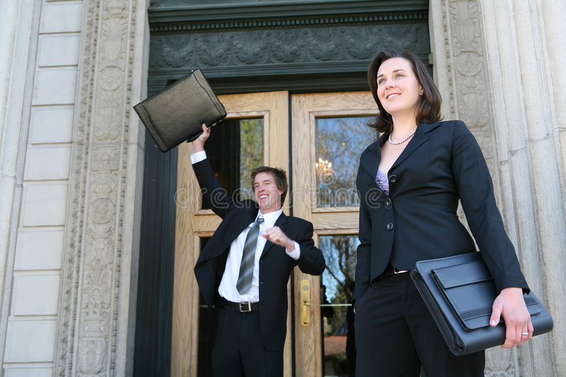 Lawyers at Court. Two lawyers celebrating a success outside of court