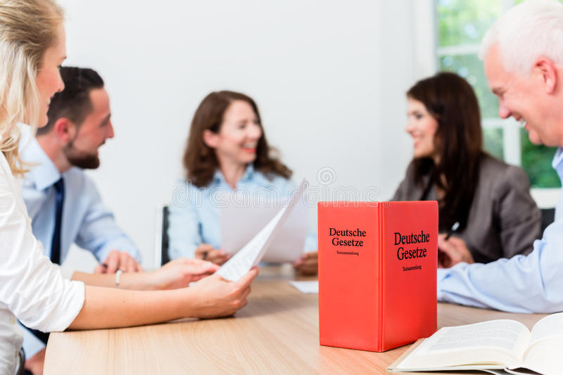 Lawyers in meeting negotiating agreement. And reading documents stock photo