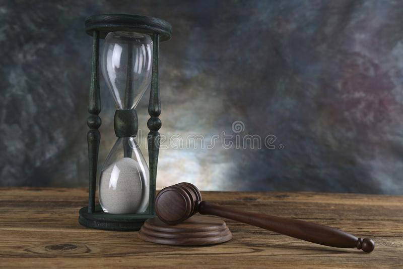 Lawyers office background. Law symbols composition on gray stone background.  royalty free stock photo