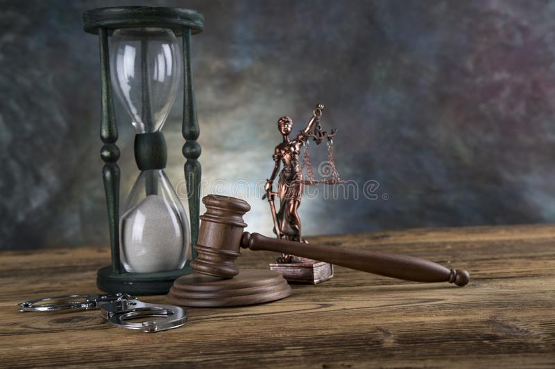 Lawyers office background. Law symbols composition on gray stone background.  royalty free stock photography