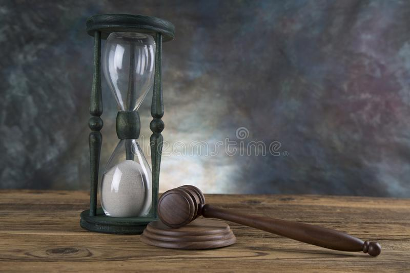 Lawyers office background. Law symbols composition on gray stone background.  stock photo
