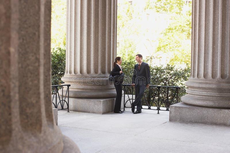 Lawyers Talking Outside Courthouse. Full length of two attorneys talking outside courthouse stock image