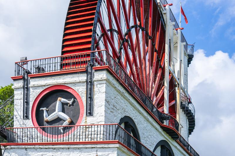 The Laxey Wheel also known as Lady Isabella is built into the hillside above the village of Laxey in the Isle of Man. It is the. Largest working waterwheel in stock photography