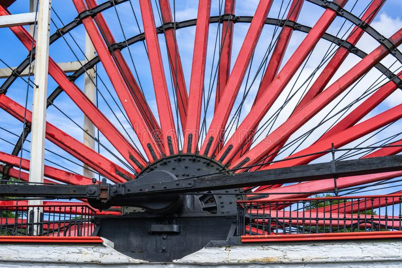 The Laxey Wheel also known as Lady Isabella is built into the hillside above the village of Laxey in the Isle of Man. It is the. Largest working waterwheel in royalty free stock photo