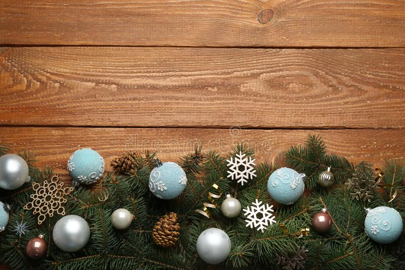 Lay composition with Christmas decorations on wooden background, space for text. Winter season. Flat lay composition with Christmas decorations on wooden royalty free stock images