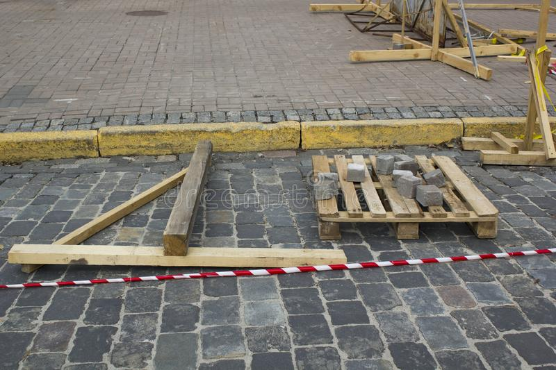 Lay granite cubes on a pallet at the stone road. Reconstruction of sidewalk with cobblestone stock images
