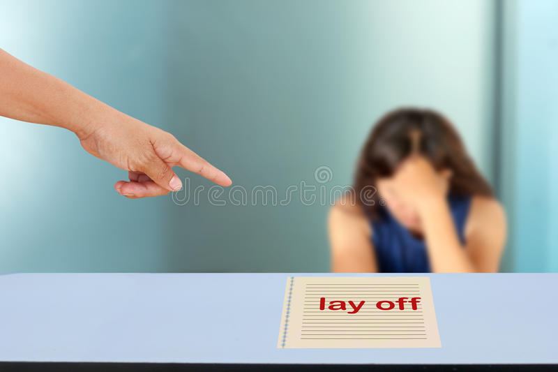 Lay off. The concept of people dismissal or lay off an employee stock image