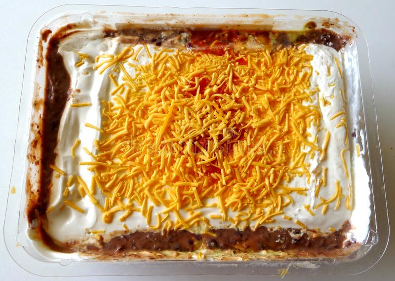 7 Layer Dip. A seven-layer dip is an American appetizer based on common ingredients in Tex-Mex cuisine royalty free stock photo