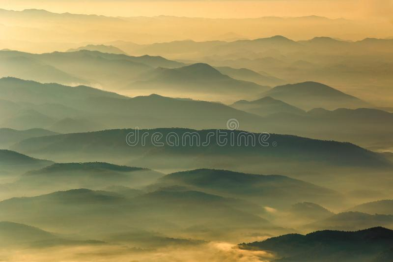 Layer of mountains and mist at sunset time royalty free stock photo