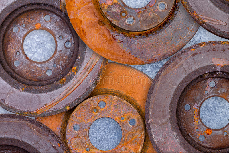 Layer of overlapping old rusty brake rotors stock photo