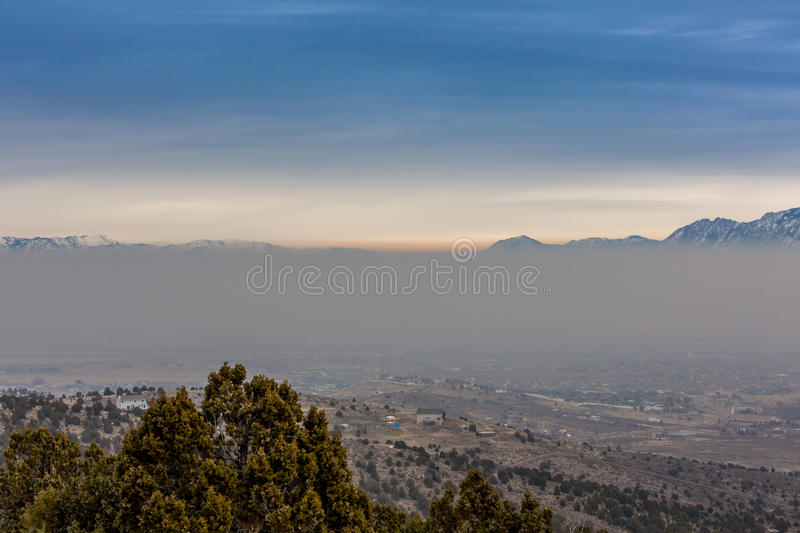 Layer of Smog. Settling over the city. Inversion layer visible. This is the south end of the Salt Lake County. Looking north east royalty free stock photos